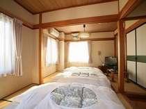 禁煙セルフ和室のお部屋です。写真はお布団を敷いた状態です。