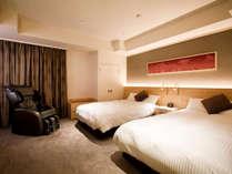 【本館特別室】(12畳+ツインベッド/78平米)ツインルームにはシモンズ社のセミダブルマットレスを採用。