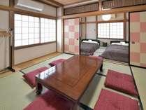 ダブルベッド2台、布団3組可能な客室