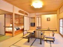 【和モダンスタンダード】伊豆石の内風呂を配した和洋室です。