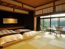 シモンズのベッドを配した半露天風呂付き和洋室