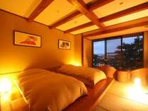 ローベットタイプのツインルーム。低めのベットが安心と安らぎを与えてくれます。