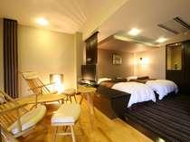 プレミアムルーム洋室 シモンズ製ツインベッドでごゆっくりお寛ぎ下さいませ。