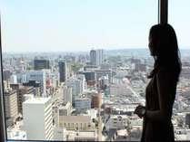 <午前11時>大分側の景色です。お昼は高層階から遠くの景色まで眺める事ができます。