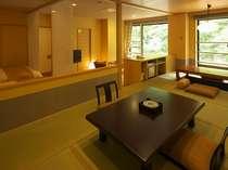 「別邸六花 2階きぶし」は半露天付和洋室、通常のツインベッドタイプ。こちらは和室・堀ごたつ部分