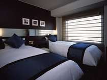 【ツインルームB 15.3平米】心地よい空間を演出するため工夫をこらしたルームデザインを採用