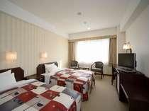 ツインルーム【広さ23平米】ツインも従来のビジネスホテルとは一線を隔したゆとりある空間です。