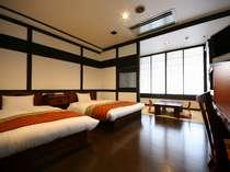 【客室】和洋室 寝具はマイナスイオンを発生させる「サンゴ」が練り込まれております。
