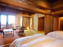 まるで化粧水のような湯ざわりの潮崎温泉を湛える専有露天風呂を全室に備えた特別客室(写真はTypeB)