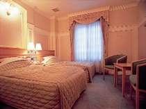 お部屋一例 はまなす館洋室ツインルーム(写真はピンク調)