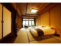 和室(ツイン)、ベットタイプのお部屋で、2階の窓からは庭園が一望できます。