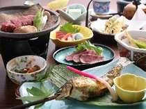 夕食は食事処にご用意いたします。飛騨牛&川魚をお楽しみください。