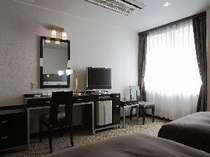 デラックスツインルーム 広々24平米のツインルームでごゆっくりお寛ぎ頂けます。