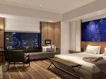 キングサイズベッド1台を備え、コンテンポラリーなデザインと機能性を両立させた38平米の客室