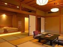 【和洋室 70平米】ベッドルームと広々とした和室を組み合わせた空間が魅力の客室。