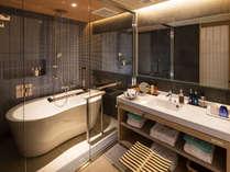 【最上階◇プレミアムツイン-バスルーム】当客室ならではのスタイリッシュのデザインのバスルームを実現。