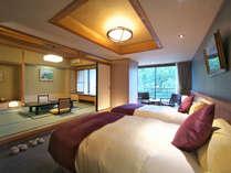 【リニューアル和洋室】シモンズ製ベッドを備えたこだわりの和洋室。広く洗練されたリニューアル客室です。