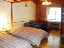 *【客室一例】当館でいちばん広い、2階建てのメゾネットタイプ。