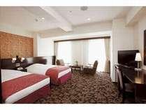 かりゆしツイン:最も広いツインルームで、落ち着いた質感のお部屋