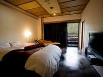 クイーンサイズのダブルベッドをしつらえた露天付きダブルルーム(写真は一例です。)