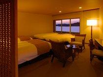 4名定員の洋室です。ご夕食にお出かけの際にベッドをご用意いたします。