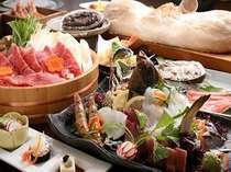 牛しゃぶ鍋材料と姿造りは2人盛り、「かに かまくら」は4名様までに1枚付き。アワビ・カニは選択料理。