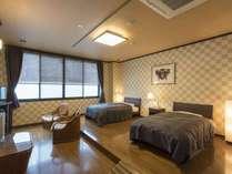 ゆったりした和洋室ツインベッド特別室。ごゆっくりとお寛ぎいただけます。
