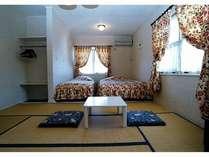 本館の和洋室は36平米の広さ。この写真の左側にフローリングのリビングもあります。
