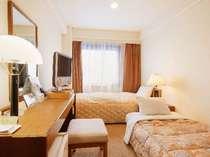 エコノミーツインルーム(シングルベッド+エキストラベッド) 15平米