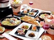 ある日の夕食(一例、写真は2名分)地場の山菜やオーナー夫人の出身地えりもの魚介をご用意致します。