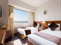 【カジュアルツイン】ベッド幅85cmx2台。気の合う仲間と過ごすのに最適なお部屋です