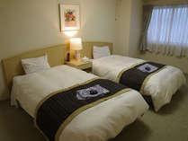 客室のベッドルーム