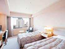 ツインルームは約20~25平米のお部屋に、幅97センチのベッドを2台配置。