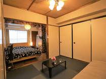 Room 5Fのリビング、ベッドルーム