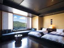 【洋室 】フローリングにローベッドを設置した洋室です。遠州綿紬の設えを施しました